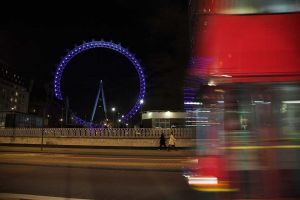 Wheel and bus at night