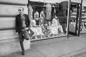 Cool man outside tartan shop, Regent Street