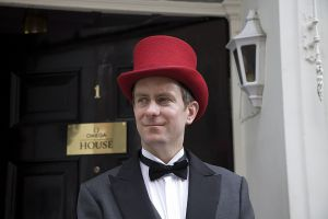 London doorman wearing red hat